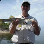 a tampa fisherman with a snook