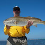 a tampa fisherman with a redfish