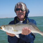 a tampa fisherman with a sea trout