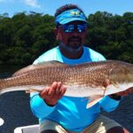 fisherman with redfish in tampa bay