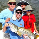 family holding a snook